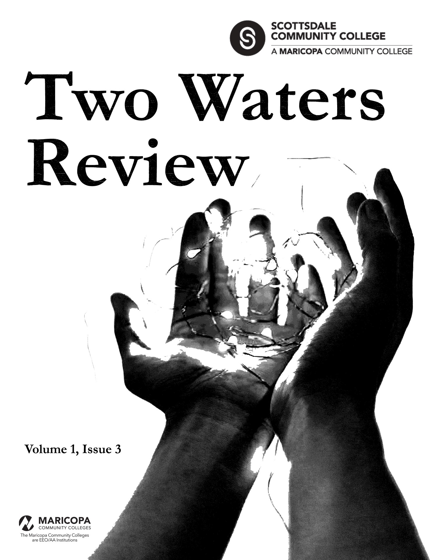 Two Waters Review 1.3 cover image showing hands holding up lights