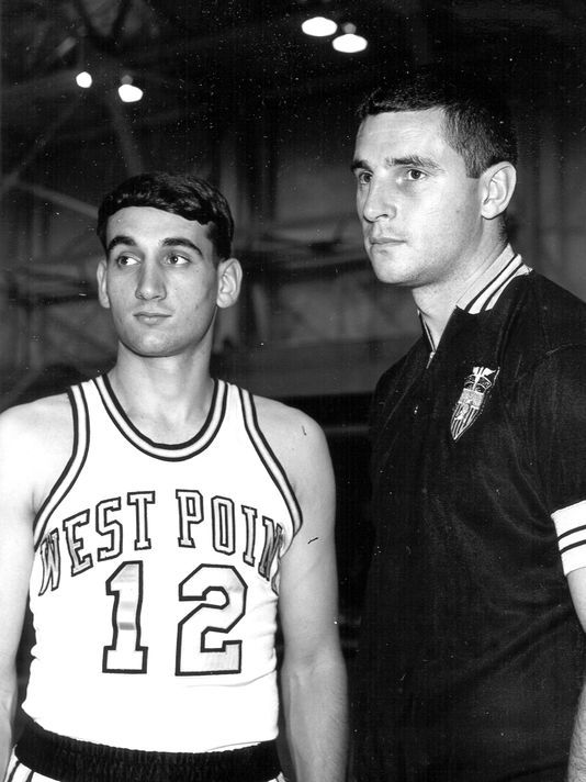 Mike Krzyzewski, point guard at Army in basketball jersey with Bob Knight, coach at Army Academy in 1960's.
